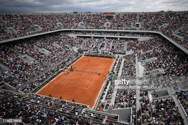TOPSHOT General view of the Philippe Chatrier court during the men's singles first round match between Switzerland's Roger Federer and Italy's...