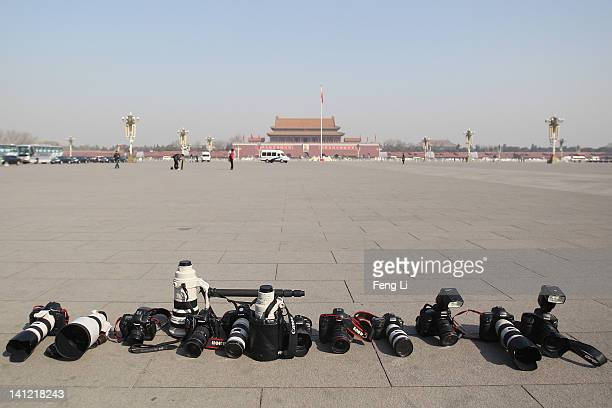 General view of the photojournalists' cameras and lenses at the Tian'anmen Square after the closing ceremony of the Chinese People's Political...