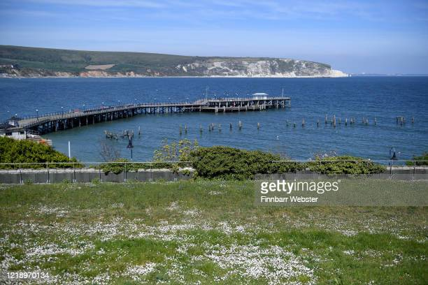 General view of the pier and coastline on April 15, 2020 in Swanage, United Kingdom. The Coronavirus pandemic has spread to many countries across the...