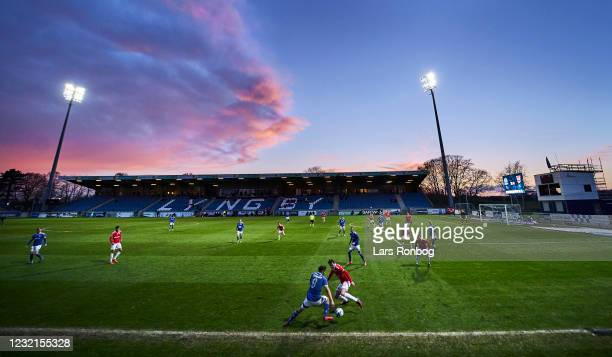 General view of the pitch and sunset during the Danish 3F Superliga match between Lyngby Boldklub and Vejle Boldklub at Lyngby Stadion on April 6,...