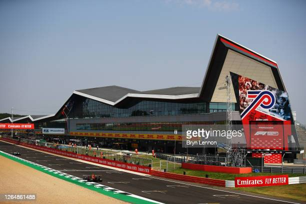 General view of the pitlane and start finish straight as Alexander Albon of Thailand driving the Aston Martin Red Bull Racing RB16 goes past during...