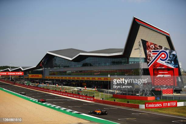 General view of the pitlane and start finish straight as Lando Norris of Great Britain driving the McLaren F1 Team MCL35 Renault goes past during the...