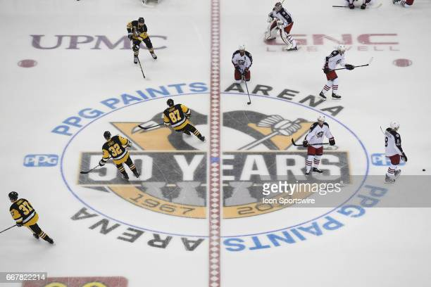 General view of the Pittsburgh Penguins 50 Year Anniversary logo as players warm up at center ice before Game One of the Eastern Conference First...