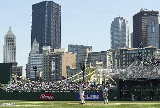 A general view of the Pittsburgh skyline with Olmedo Saenz of the Los Angeles Dodgers and Sean Casey of the Pittsburgh Pirates on the field on April...