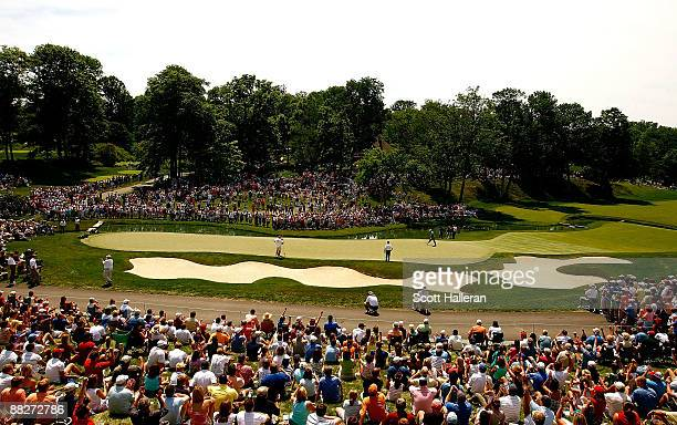 General view of the play of Tiger Woods on the 14th green during the third round of the Memorial Tournament at the Muirfield Village Golf Club on...