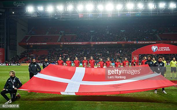 General view of the players of Denmark during the national anthems prior to the FIFA 2018 World Cup Qualifier match between Denmark and Kazakhstan at...