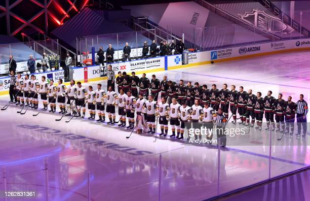 General view of the players standing on ice with locked arms, as the United States national anthem is played before the exhibition game between the...