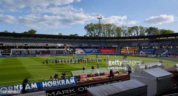General view of the players walking on to the pitch and the LED screens with fans prior to the Danish 3F Superliga match between AGF Aarhus and...