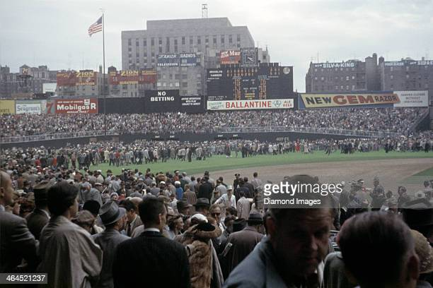 A general view of the playing field from the lower seating bowl as fans leave the stadium by walking across the outfield grass to the exits after...