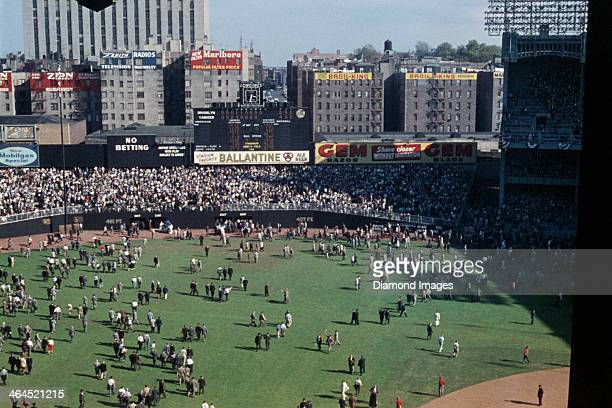 A general view of the playing field from the upper deck as the fans walk across the outfield grass towards the exits underneath the outfield...