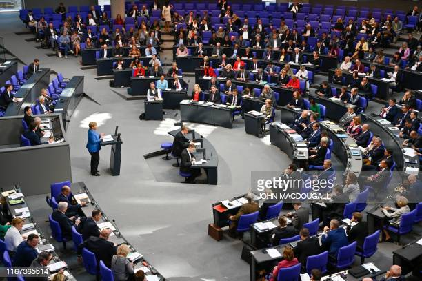 General view of the plenary as German Chancellor Angela Merkel delivers a keynote speech during a debate on the federal budget at the Bundestag, the...