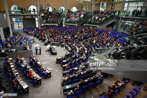 General view of the plenary as German Chancellor Angela Merkel delivers a keynote speech during a debate on the federal budget at the Bundestag the...