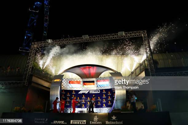A general view of the podium celebrations with race winner Sebastian Vettel of Germany and Ferrari second placed Charles Leclerc of Monaco and...