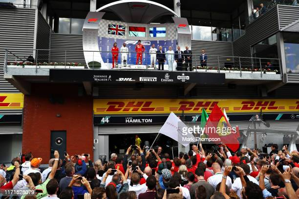 A general view of the podium with race winner Charles Leclerc of Monaco and Ferrari second placed Lewis Hamilton of Great Britain and Mercedes GP and...