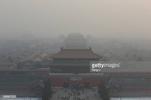 A general view of the pollution covered Forbidden City on January 16 2013 in Beijing China Heavy smog shrouded Beijing with pollution at hazardous...