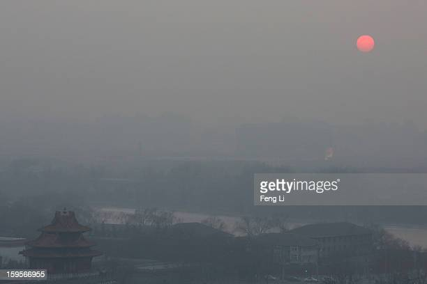 A general view of the pollution covered watchtower of the Forbidden City on January 16 2013 in Beijing China Heavy smog shrouded Beijing with...