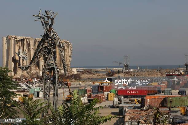 General view of the port of Beirut and the memorial sculpture of a giant angular figure made from the wreckage of last summer's Beirut port blast on...