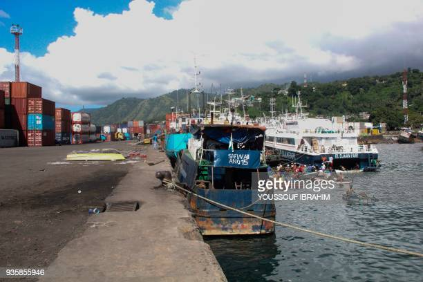 A general view of the port of Mutsamudu the capital of the Comoros Union Island of Anjouan shows fisherman waiting for incoming boats on March 21 2018