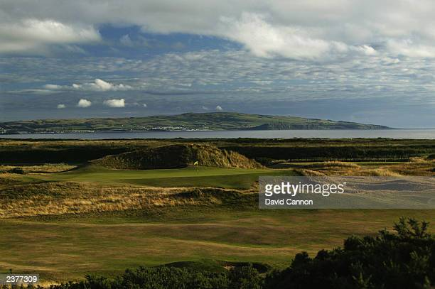 General view of the 'Postage Stamp' par 3, 8th green with the town of Ayr behind taken during a photoshoot held on July 26, 2003 at the Royal Troon...