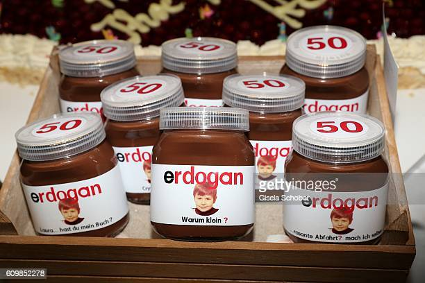 A general view of the present Glasses of Nutella with a photo when Erdogan Atalay was five years old during the surprise party for Erdogan Atalay's...