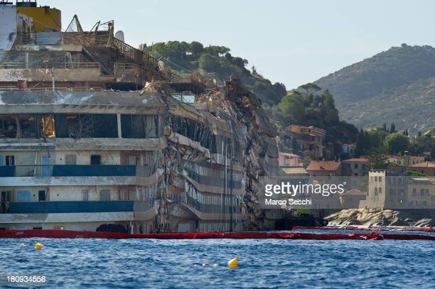 General view of the previously submerged severely damaged right side of the Costa Concordia cruise ship in upright position on September 18 2013 in...