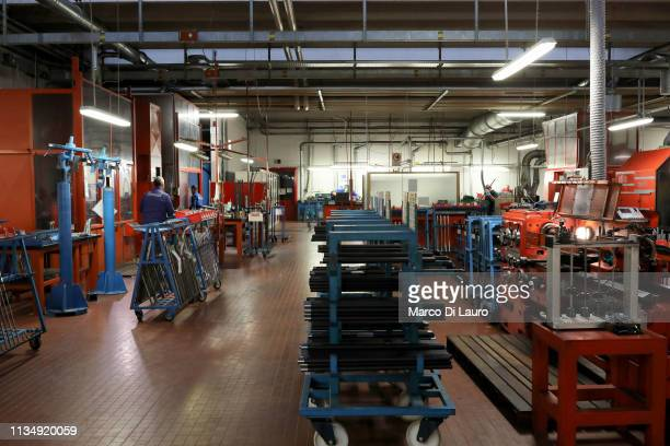 A general view of the production department of rifle barrels is seen on April 4 2019 at the Perazzi Armi factory in Botticino Mattina a village in...