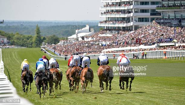 General view of the racing and grandstands leading up to the finish at the Investec Ladies Day race meeting at Epsom Downs racecourse in surrey...