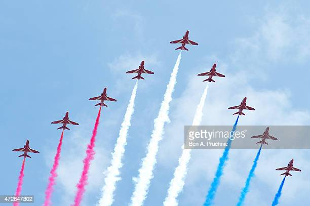 A general view of the Red Arrows fly past over Horse Guards Parade during the VE Day Parade on May 10 2015 in London England