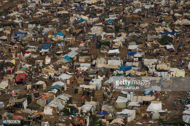A general view of the refugee camp near the airport in Bangui on December 19 2013 Amnesty International said today the Central African Republic's...