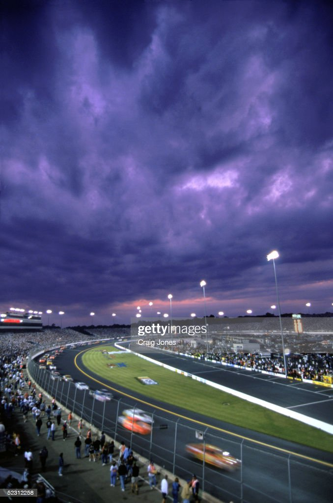 General view of the Richmond International Raceway as cars speed pass the grand stands on a cloudy night during the Pontiac Excitement 400 on June 6, 1998 in Richmond, Virginia.