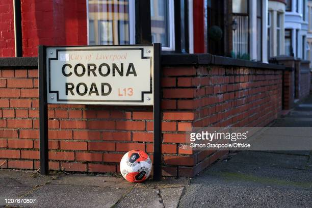 General view of the road sign for Corona Road alongside a replica Premier League football as concerns escalate over the spreading of COVID-19...