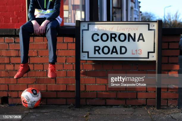 A general view of the road sign for Corona Road alongside a replica Premier League football as concerns escalate over the spreading of COVID19...