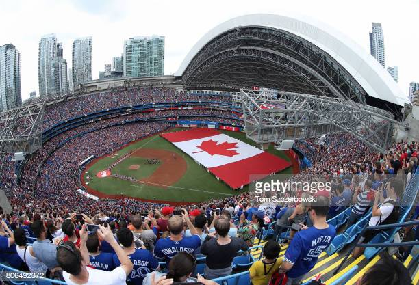 A general view of the Rogers Centre as a large Canadian flag is unfurled in the outfield on Canada Day during the playing of the Canadian national...