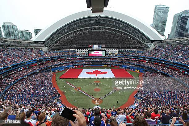A general view of the Rogers Centre with a large Canadian flag in the outfield on Canada Day before the Toronto Blue Jays MLB game against the...
