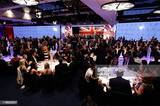 A general view of the room with guests during the Australian Olympic Committee Black Tie Dinner at the Sydney Convention Exhibition Centre on July 27...