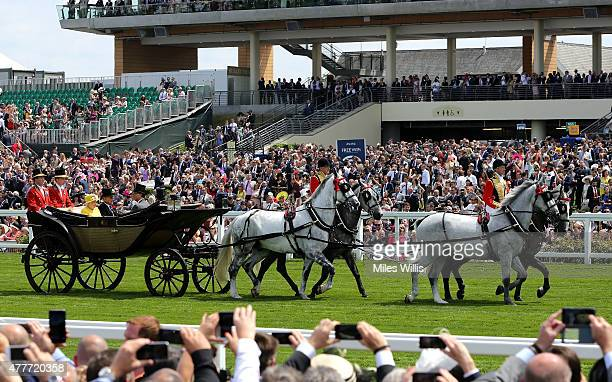 General view of the Royal Procession as the Queens carriage makes its way down the straight mile carrying Queen Elizabth II Prince Phillip Duke of...