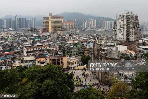 General view of the ruins of St. Paul and mainland China is pictured in Macau on December 15, 2019.