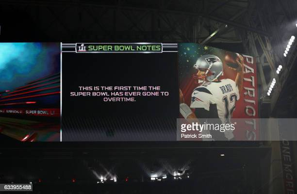 A general view of the scoreboard is seen stating this is the first Super Bowl to ever go to overtime during Super Bowl 51 between the New England...