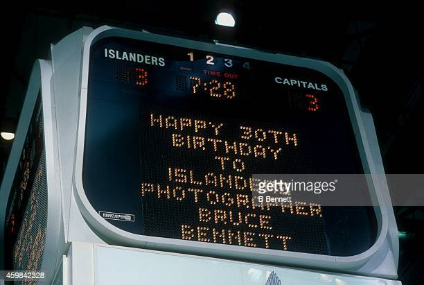General view of the scoreboard that reads 'Happy Birthday to Islanders team photographer Bruce Bennett' during the game between the Washington...
