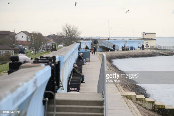 General view of the seafront as people walk along the shoreline on February 25, 2021 in Canvey Island, England. The UK government recently announced...