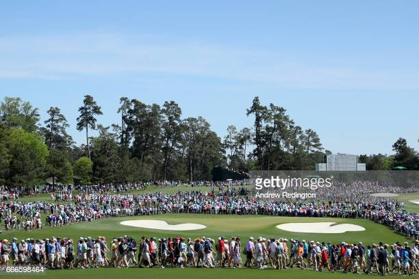 A general view of the second green is seen as patrons cross the fairway during the final round of the 2017 Masters Tournament at Augusta National...