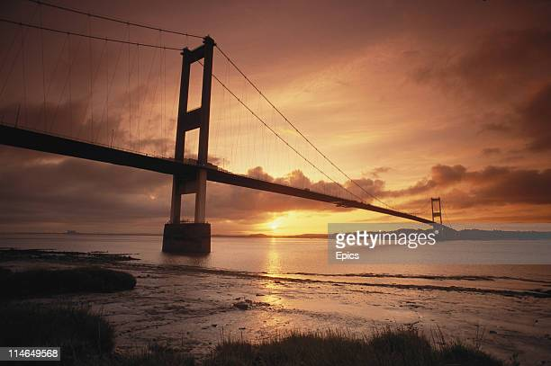 A general view of the Severn Bridge at sunset a suspension bridge which crosses the River Severn between South Gloucestershire north of Bristol...