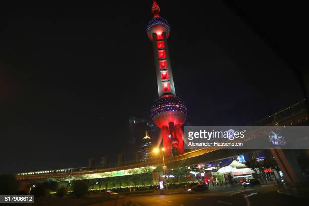 General view of the Shanghai Oriental Pearl Tower as he is illuminated in FC Bayern Muenchen colors during the Audi Summer Tour 2017 on July 18 2017...