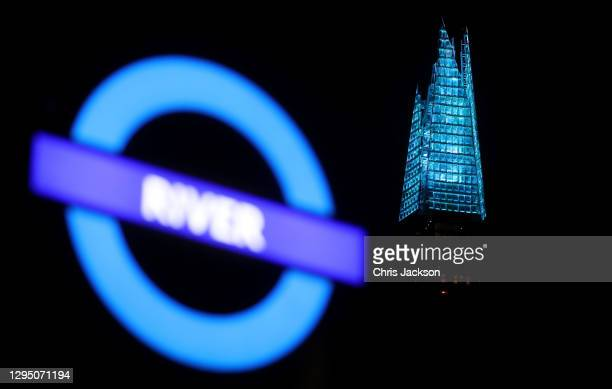 General view of the Shard as the skyline of London is lit up blue in support of the NHS on January 07, 2021 in London, England. In a renewed gesture...