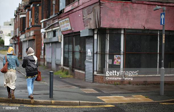 A general view of the shops on Princess Road Moss Side which were damaged during the riots of 1981 on July 7 2011 in Manchester England Thirty years...