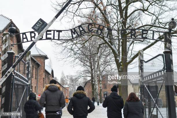 General view of the sign 'Arbeit Macht Frei' over the main entrance gate to Auschwitz I . Due to the coronavirus pandemic, the commemoration event of...