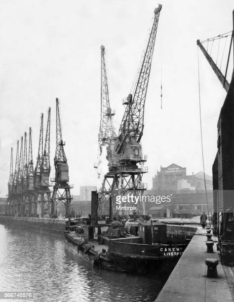 General view of the South east side of Staly Bridge dock in Garston Liverpool showing the new cranes constructed as part of the post war improvements...