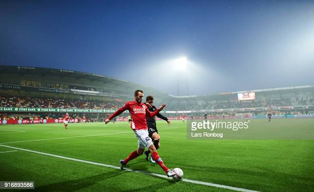 General view of the stadium and Jens Martin Gammelby of Silkeborg IF and Frederik Borsting of AaB Aalborg competing for the ball during the Danish...