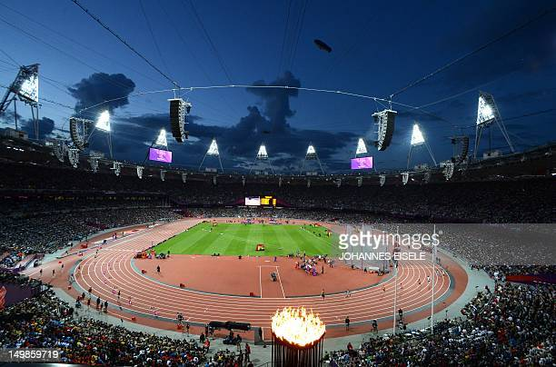 General view of the stadium and the Olympic flame during the athletics event held at the Olympic Stadium during the London 2012 Olympic Games on...