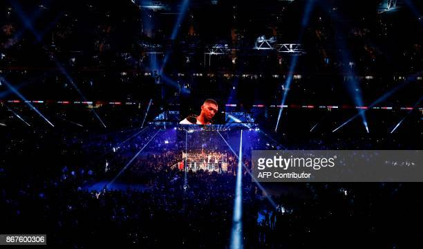 A general view of the stadium as Britain's Anthony Joshua enters the ring ahead of his world heavyweight title fight against challenger Cameroonborn...